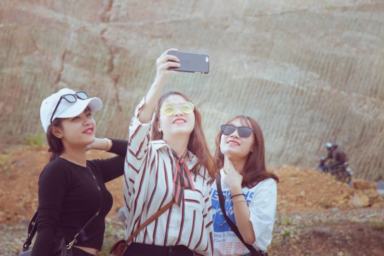 Chinese travellers taking selfie