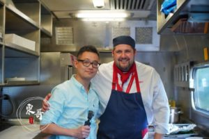 Chinese KOL standing with a chef